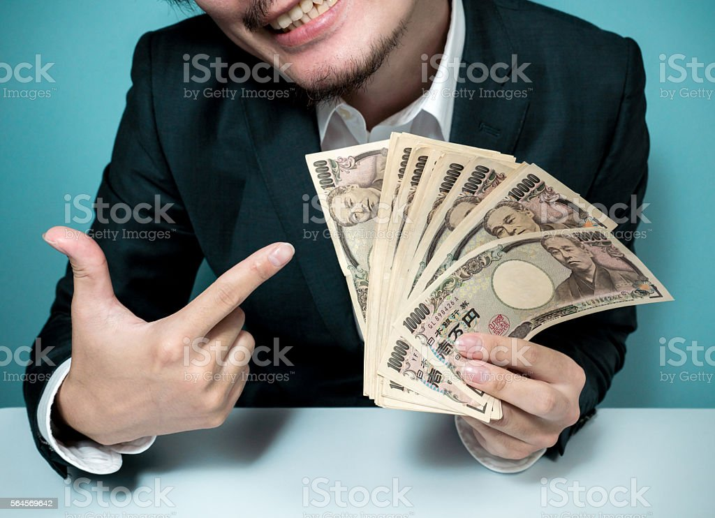 Asian man holding a lot of money stock photo