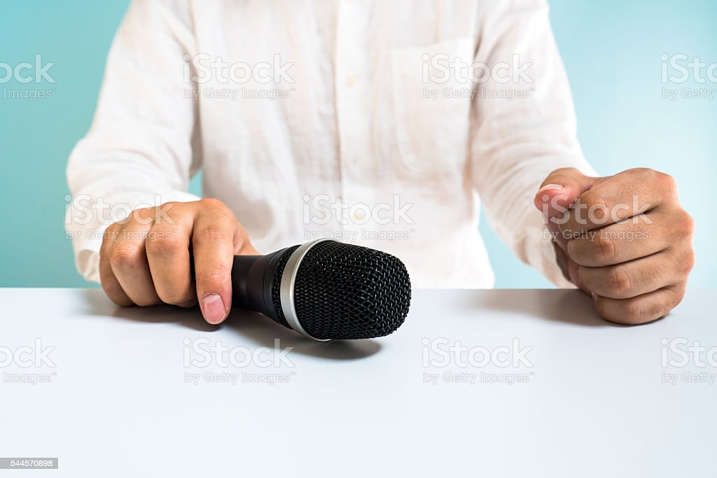 Asian man holding microphone stock photo