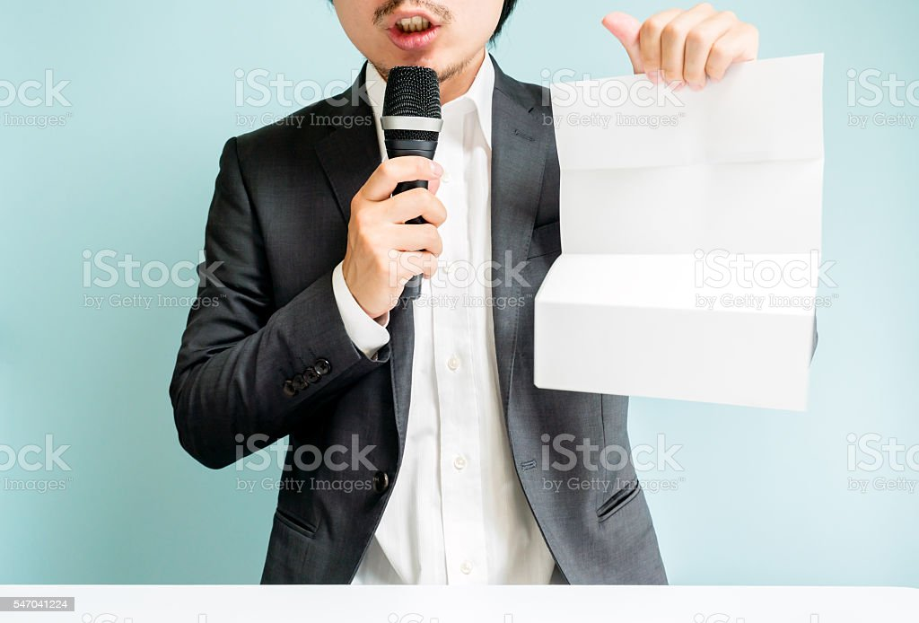 Asian man holding white paper stock photo