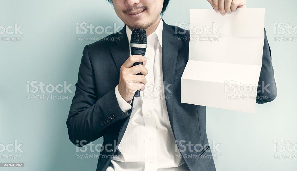 Asian man holding white paper stock photo