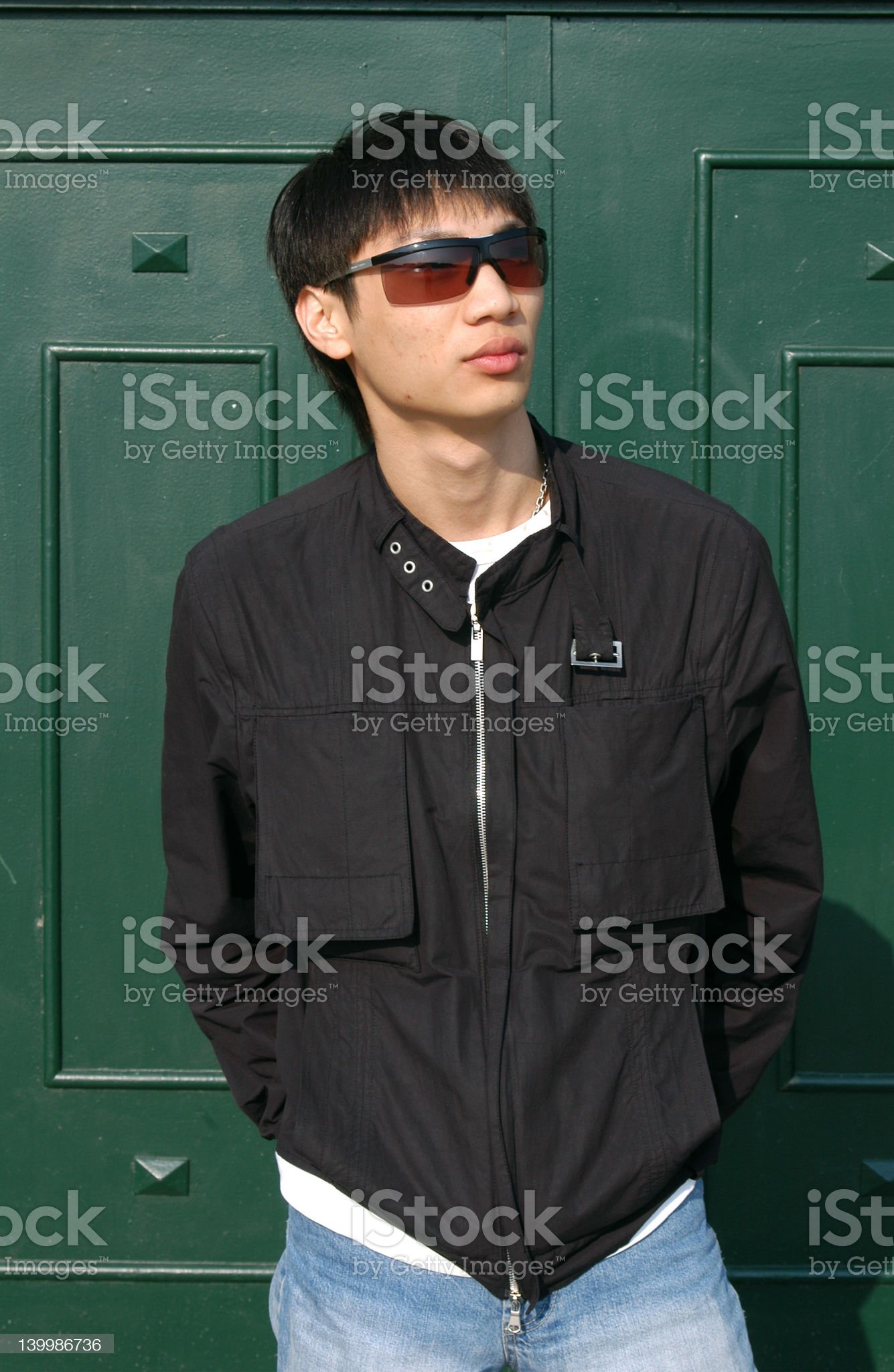 Asian Man in front of a Door royalty-free stock photo