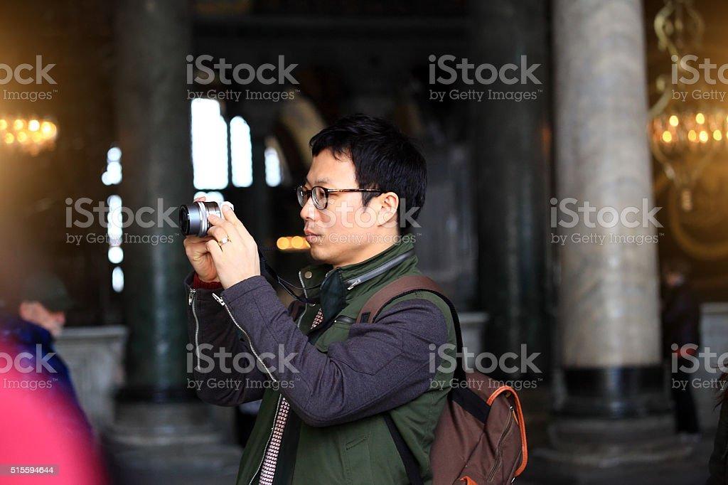 Asian Man in Hagia Sophia stock photo