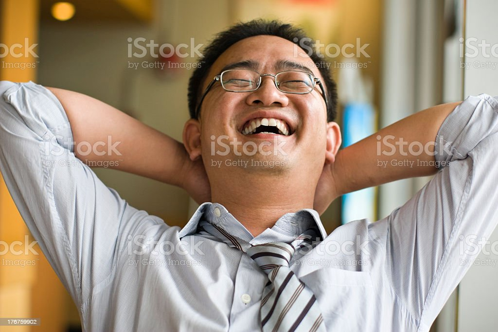 Asian man laughing and smiling stock photo