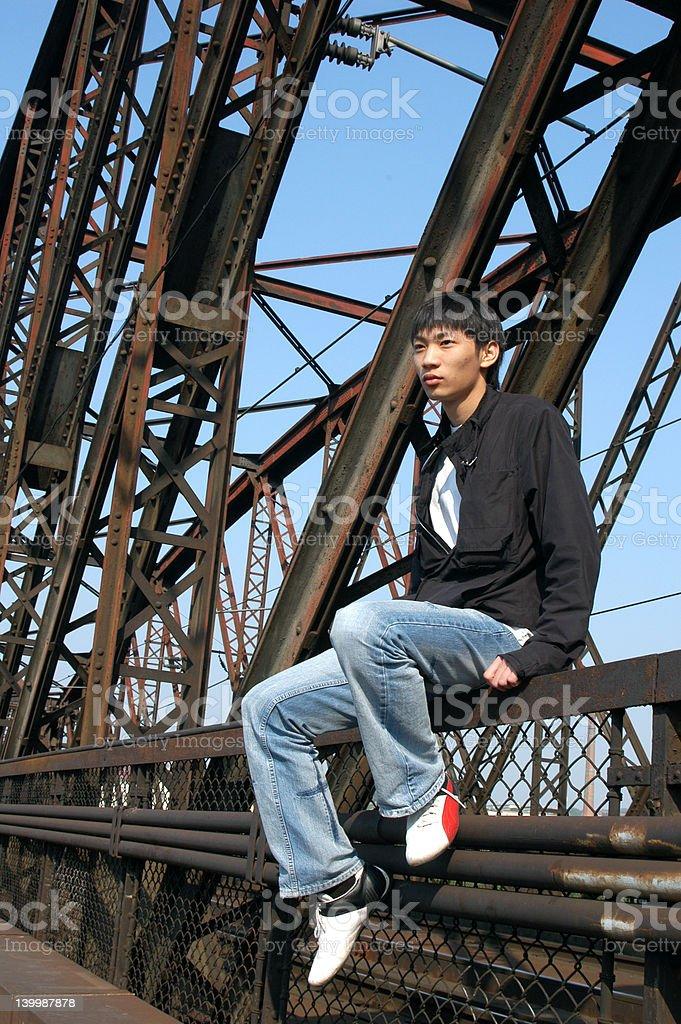 Asian Man on the Bridge royalty-free stock photo