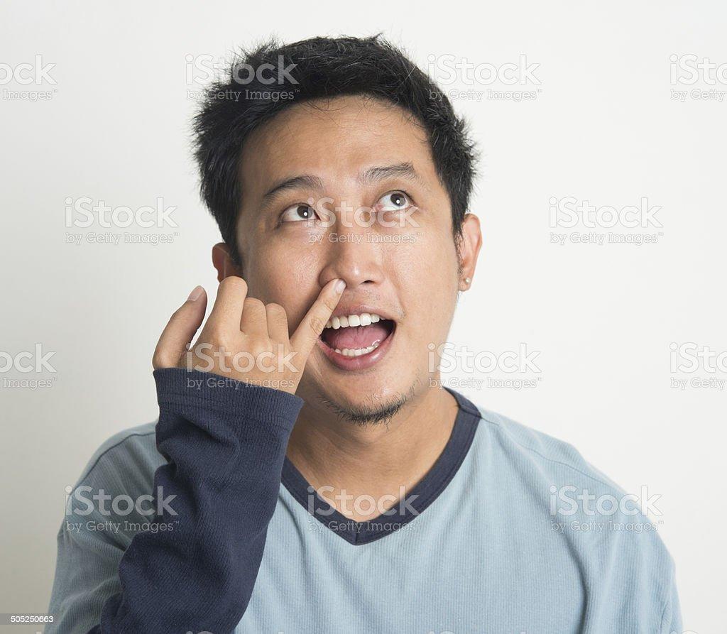 Asian man picking nose royalty-free stock photo