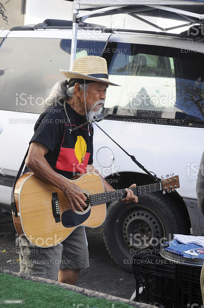 Asian man playing guitar. stock photo