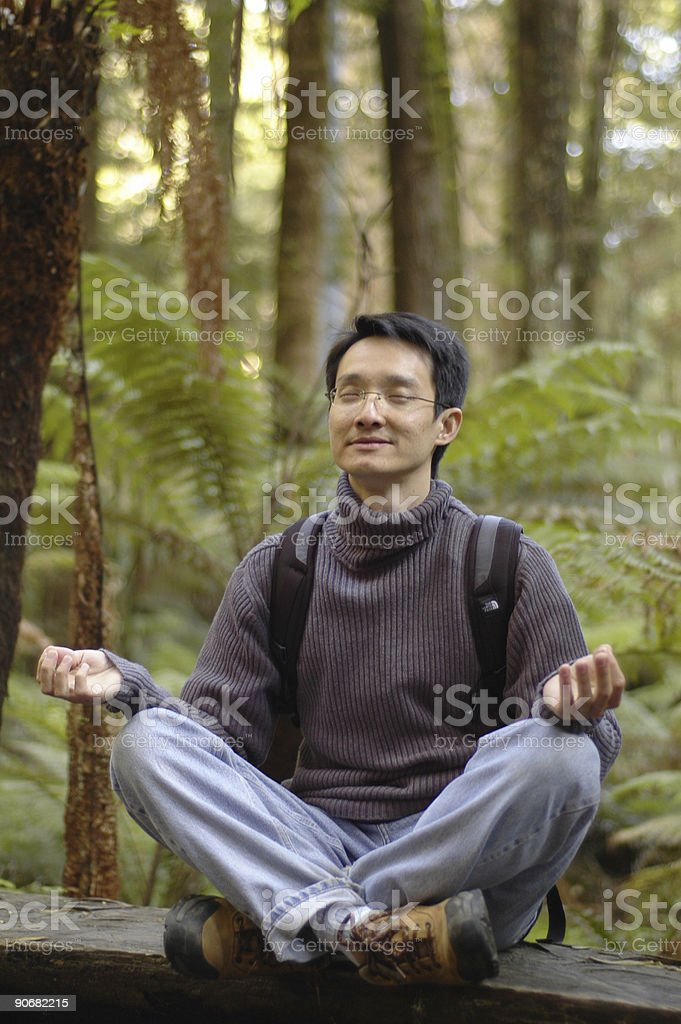 Asian man practising yoga royalty-free stock photo