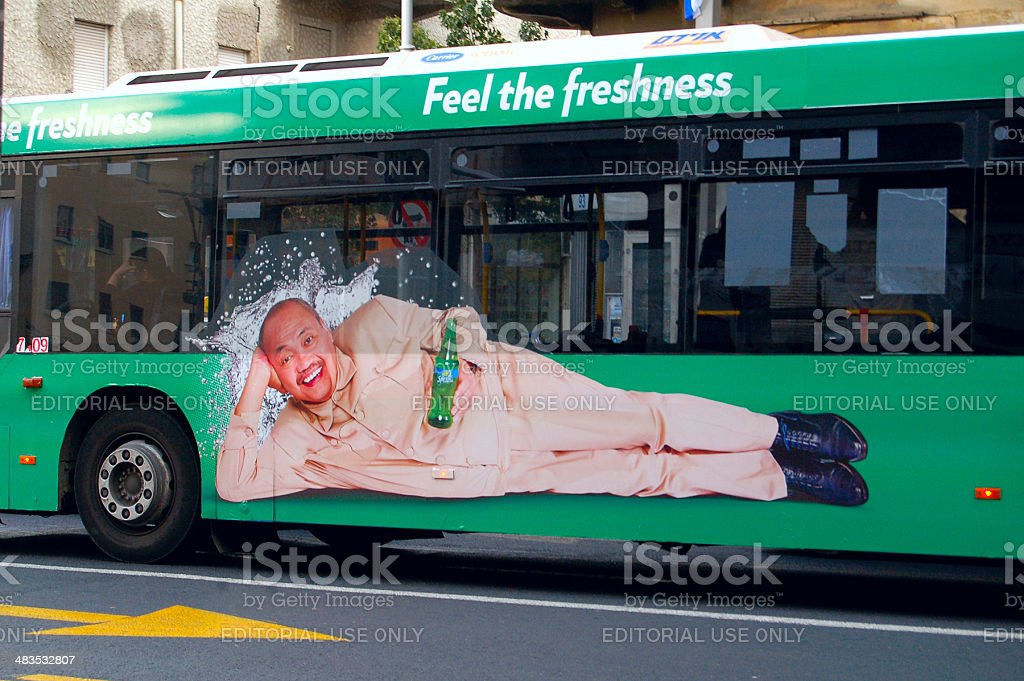 Asian man shows Sprite stock photo