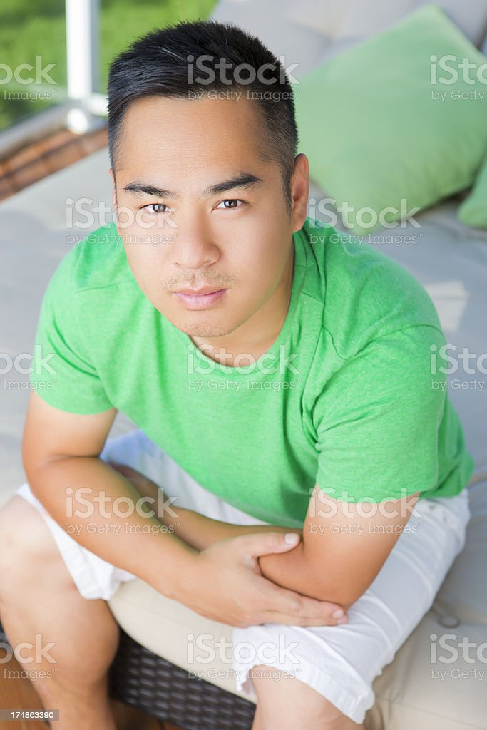 Asian man sitting on day bed outdoor royalty-free stock photo