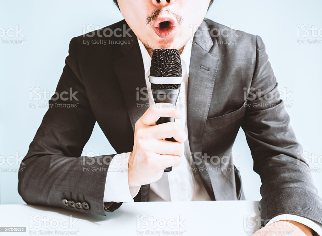 Asian man snapping back stock photo