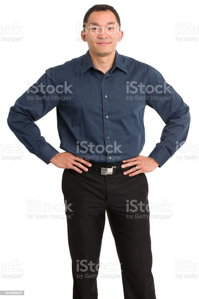 Asian Man Standing With Hands on Hips stock photo