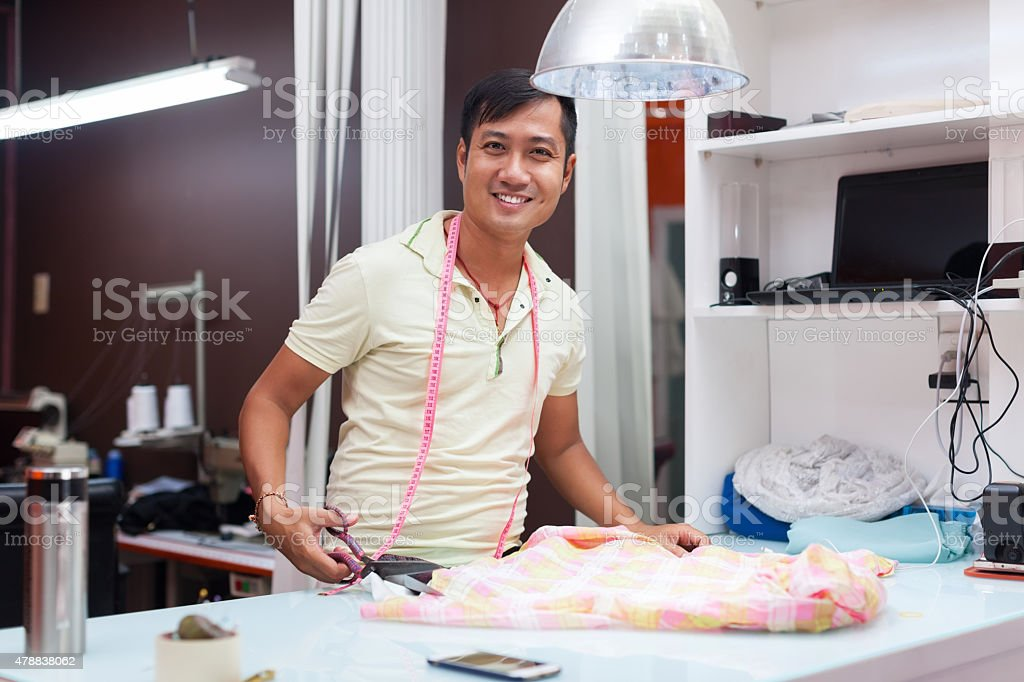 Asian man tailor fashion clothes dress designer stock photo