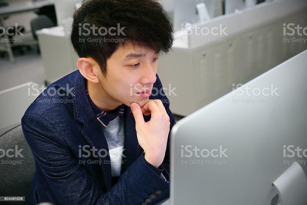 asian man thinking stock photo
