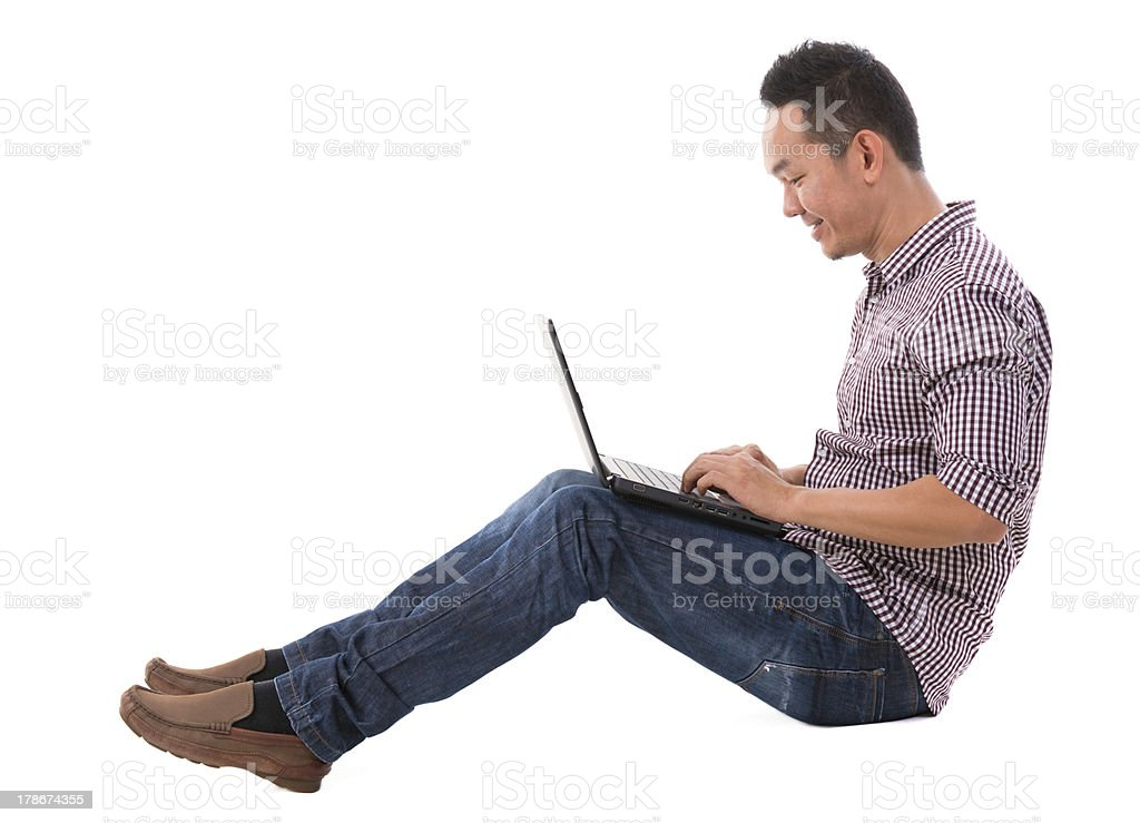 Asian man using laptop royalty-free stock photo