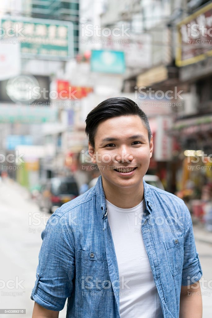 Asian man walking on the street stock photo