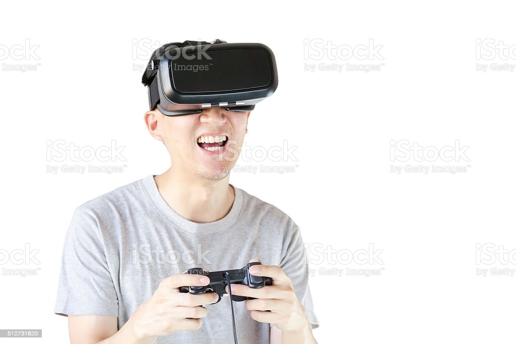 Asian man wearing VR goggle and gaming stock photo