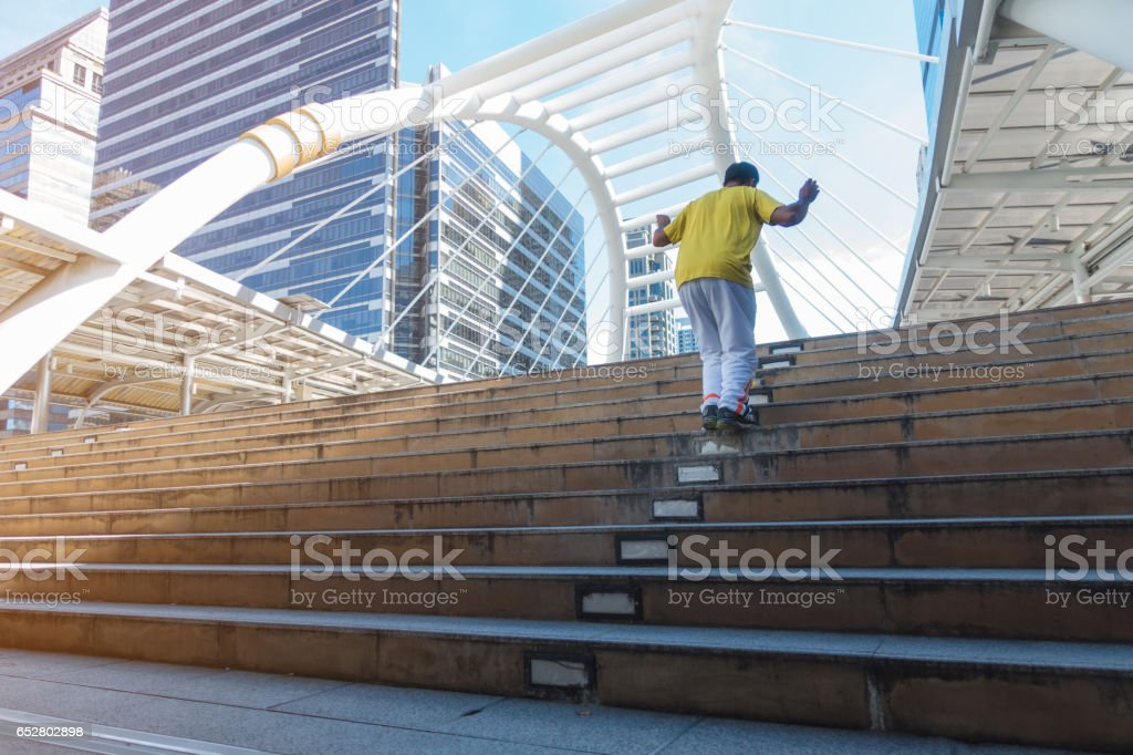 Asian man wearing white pants yellow shirt hop stock photo