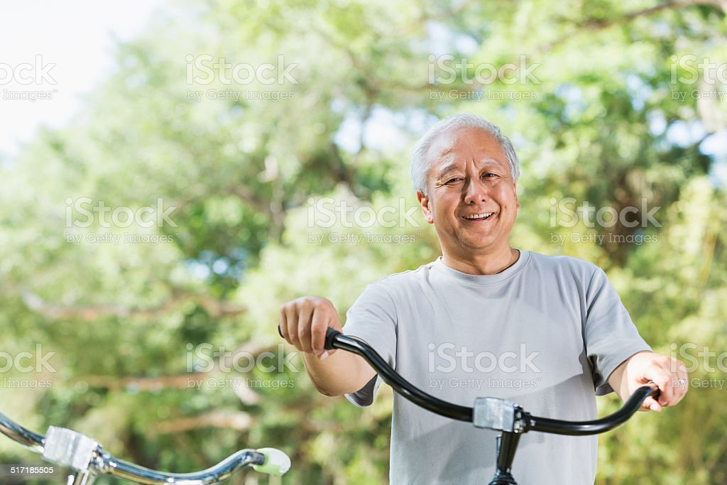 Asian man with bicycle stock photo
