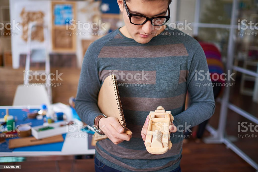 Asian man with wooden toy stock photo