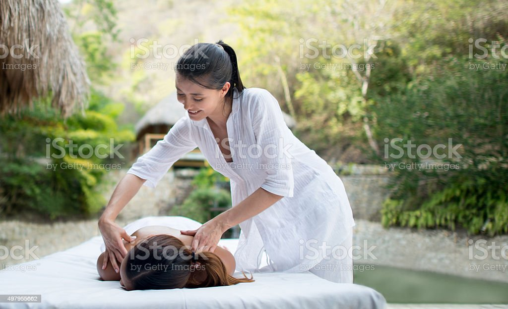 Asian masseuse working at a spa stock photo