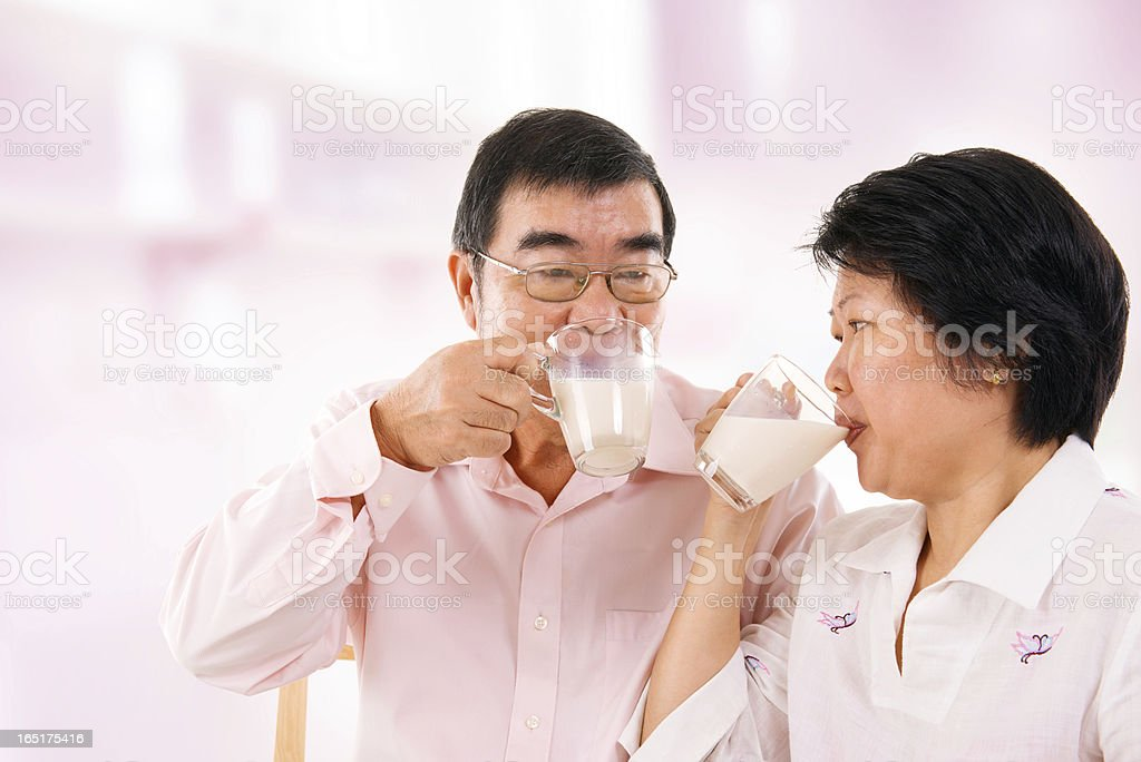 Asian mature couple drinking soy milk royalty-free stock photo