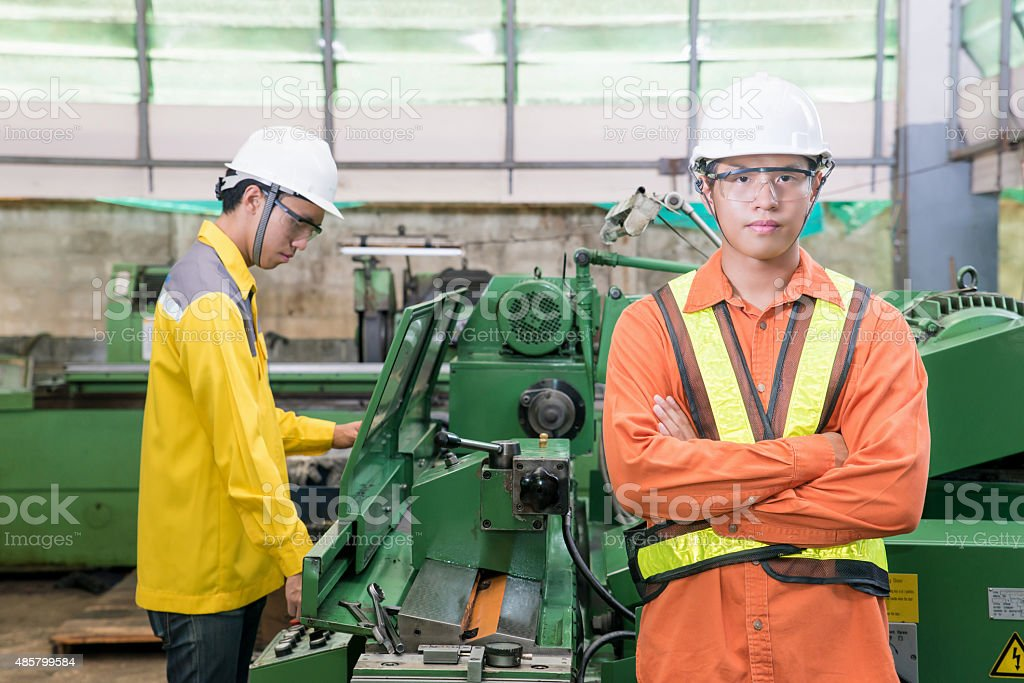 Asian Mechanical Engineer working in factory stock photo