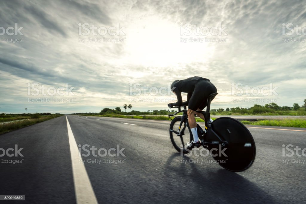 Asian men are cycling 'time trial bike' in the morning stock photo