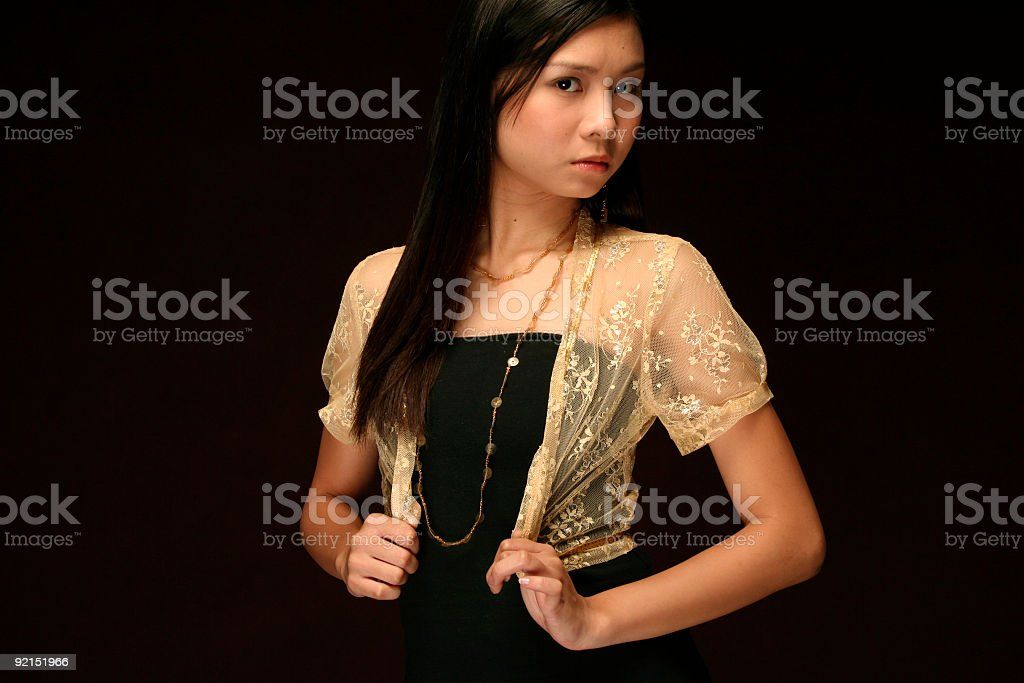 asian model against a dark brown background royalty-free stock photo