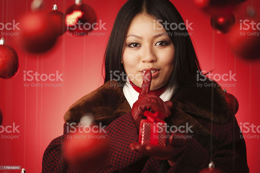 Close-up of a Happy young Asian woman celebrating Christmas holding a...