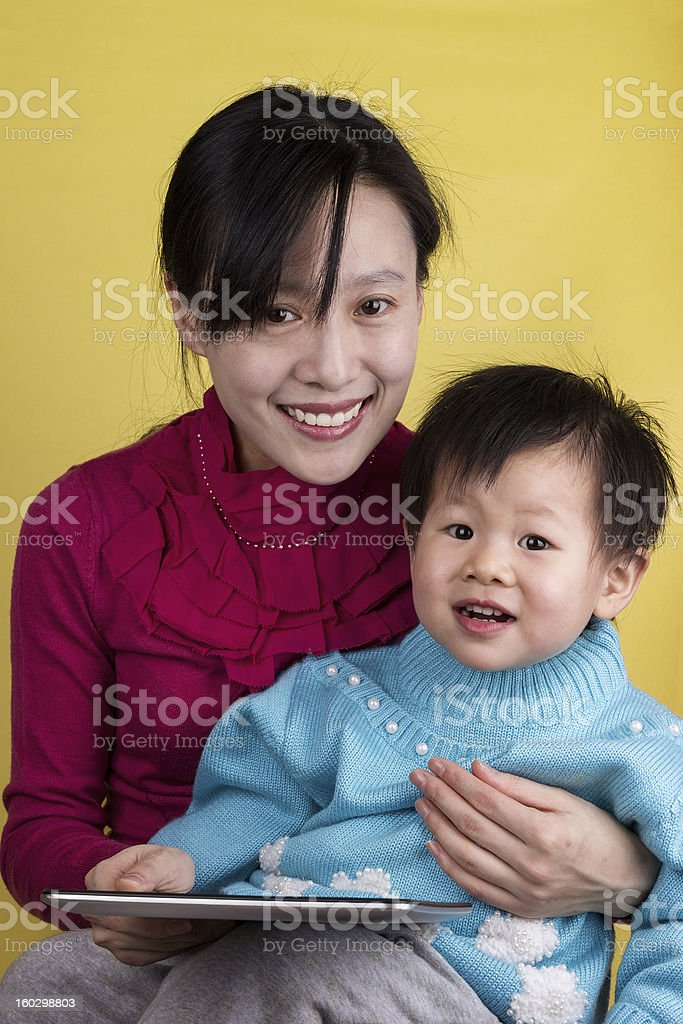 Asian mother and baby using tablet computer stock photo