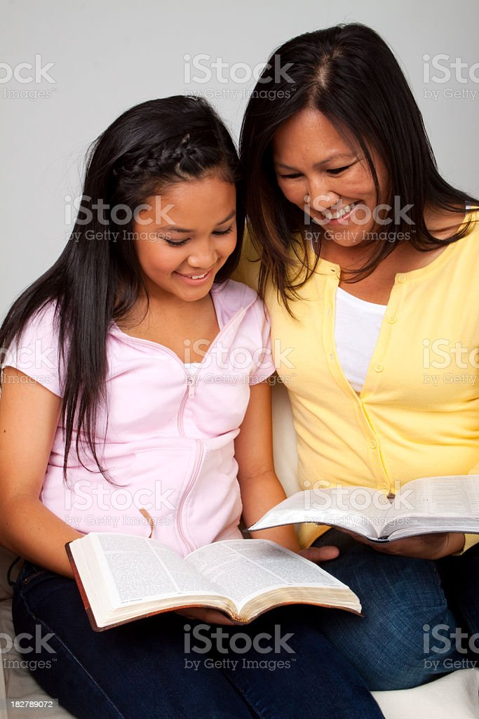Asian Mother and Daughter Reading royalty-free stock photo