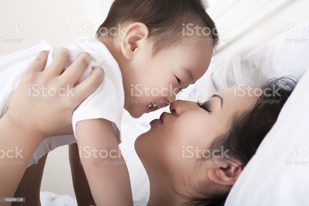 Asian mother and son bedroom portrait royalty-free stock photo