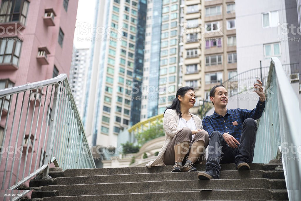 Asian Mother and Son Posing for Selfie in Residential Area stock photo