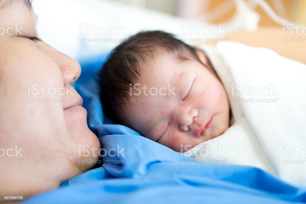 Asian mother with newborn baby in the hospital stock photo