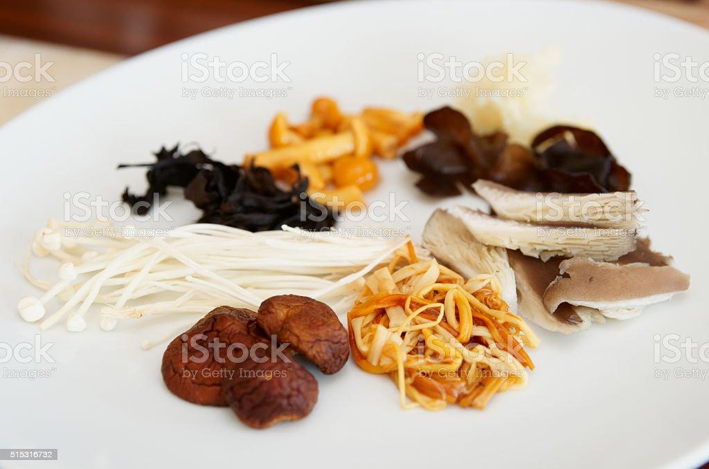 Asian mushrooms on plate stock photo