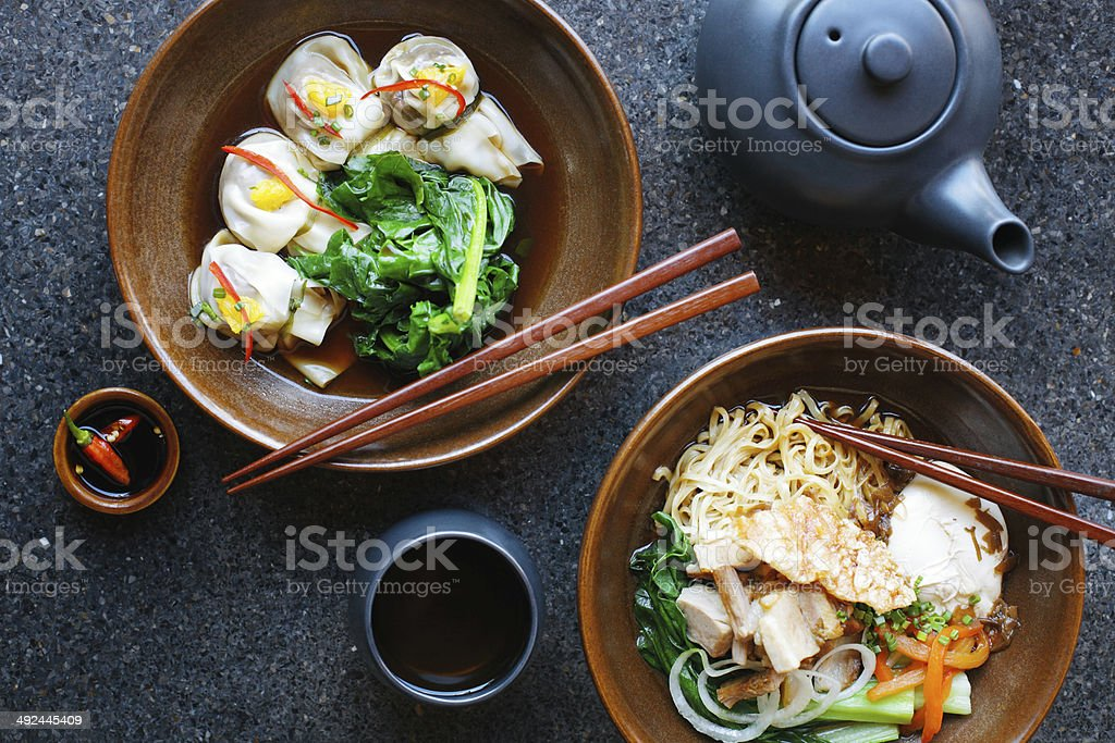 Asian noodles and dumplings stock photo