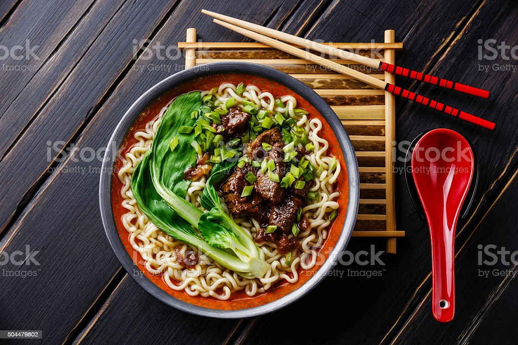 Asian noodles with beef and pak choi cabbage stock photo