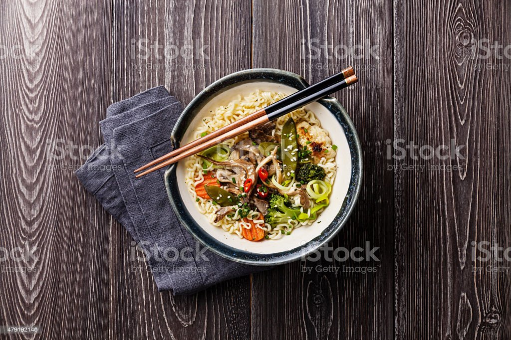 Asian noodles with oyster mushrooms and vegetables stock photo