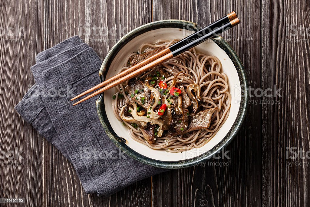 Asian noodles Yakisoba with beef and oyster mushrooms stock photo