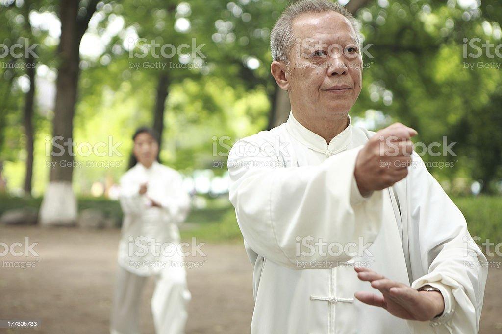 asian old man taichi outdoor stock photo