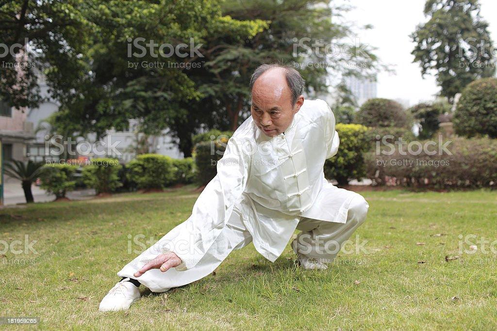 asian old man taichi outdoor royalty-free stock photo