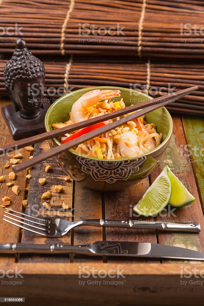Asian Pad Thai with prawns and chicken stock photo