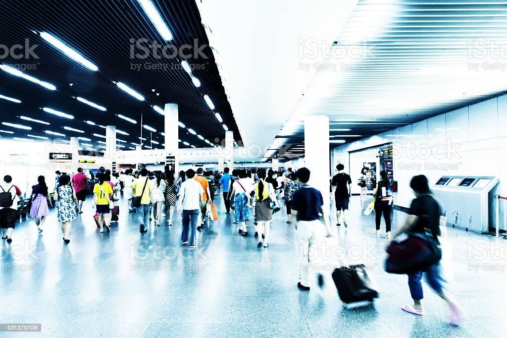 asian passengers walking in rush hour stock photo