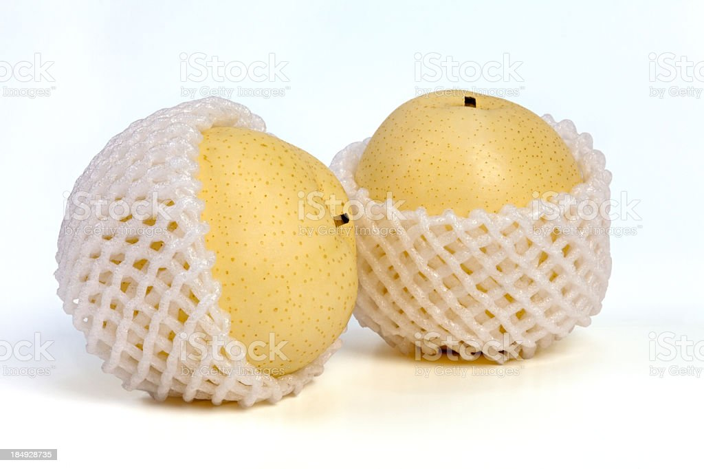 Asian Pears in shipping net stock photo