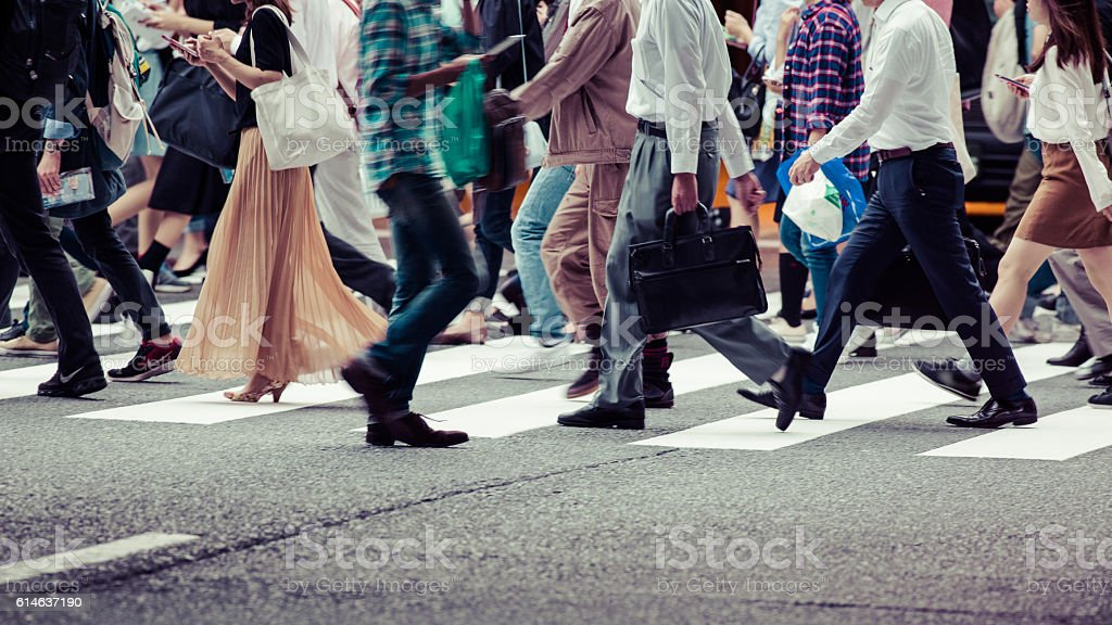 Asian People are across the crosswalk stock photo