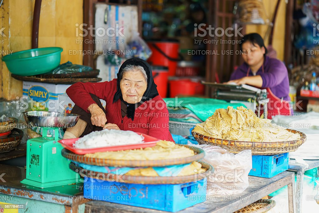 Asian people preparing noodles for selling in Vietnam stock photo