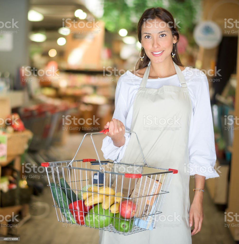 Asian personal shopper at the supermarket stock photo