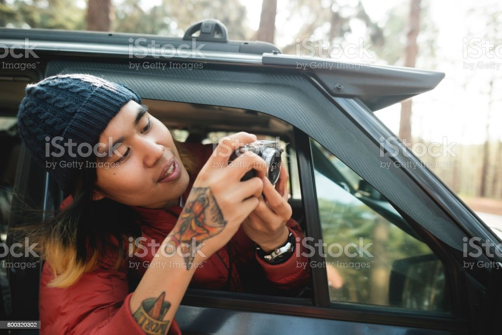 Asian Photographer Taking Pictures Outdoors Concept stock photo