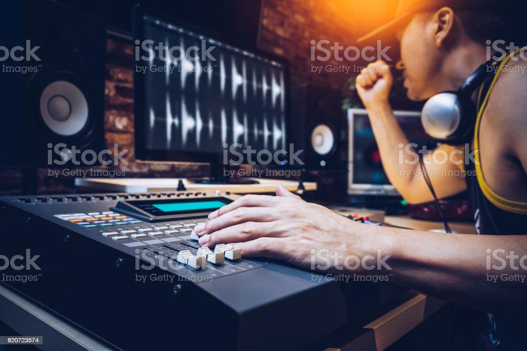 asian popular DJ working in radio broadcasting studio or music producer working in recording studio stock photo