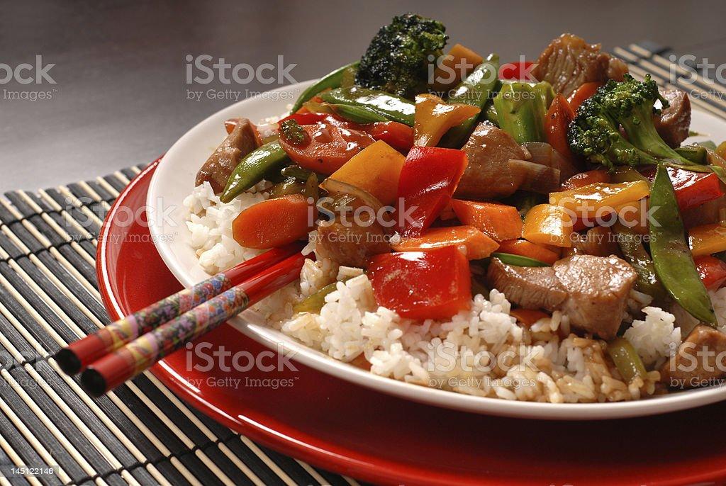 Asian pork stir fry with chop sticks royalty-free stock photo